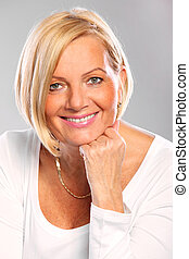 Elegant woman - A portrait of a mature elegant woman smiling...
