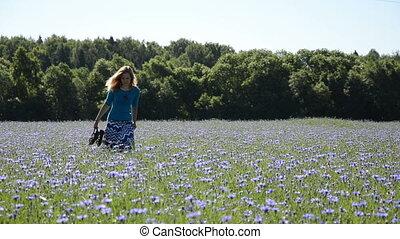 elegant woman bluet field