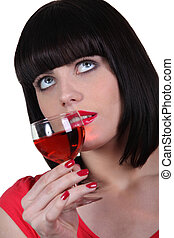 elegant woman drinking wine