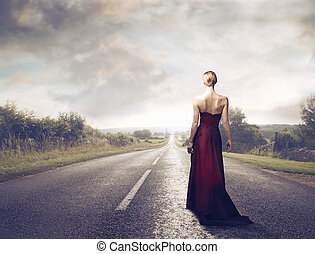 elegant woman - elagant woman turn back walking on the road