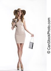 Elegant woman holding a small dog