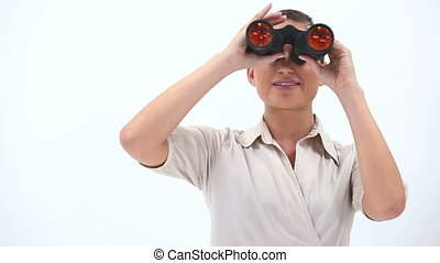 Elegant woman holding binoculars