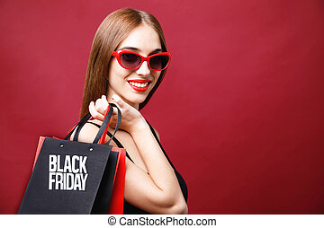 Elegant Woman Holding Black Friday Shopping Bag