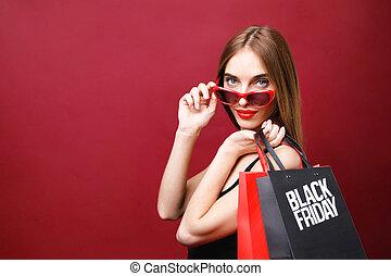 Elegant Woman Holding Black Friday Shopping Bag