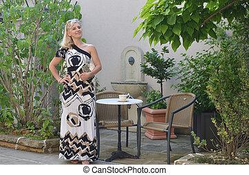 Elegant Woman in a Summer Garden