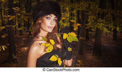 Elegant woman in autumn style.