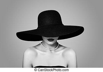 Elegant woman in classic hat, retro black and white portrait