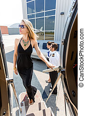 Elegant Woman In Dress Boarding Private Jet