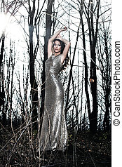 elegant woman in forest