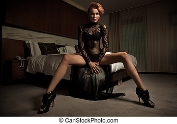 Elegant woman in hotel room
