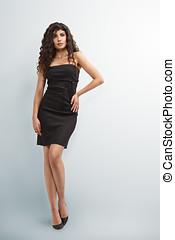 Elegant woman in little black dress