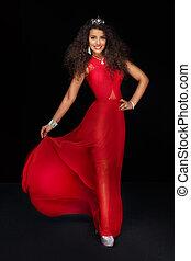 Elegant woman in red maxi dress.