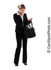 elegant woman in suit with bag