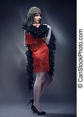Elegant woman in the red dress and feather boa. Retro style....