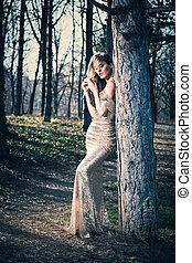 elegant woman in wood