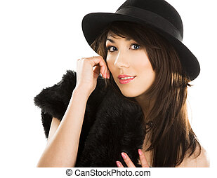 elegant woman is in a hat