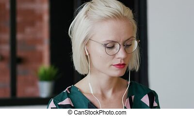 Elegant woman listening to music at home - Beautiful young...