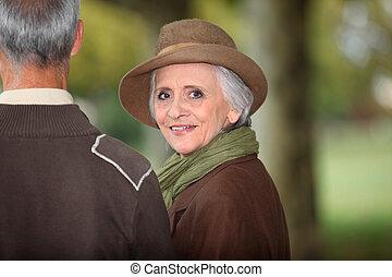 Elegant woman looking over her shoulder