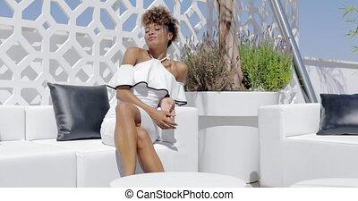Elegant woman on terrace - Young ethnic model in elegant...