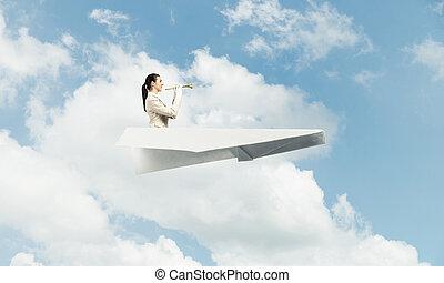 Elegant woman playing trumpet brass
