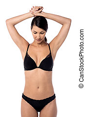 Elegant woman posing in black lingerie