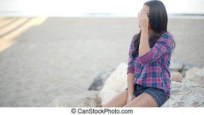 Elegant Woman Posing On The Beach