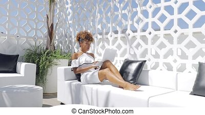 Elegant woman relaxing on balcony - Young trendy woman in...