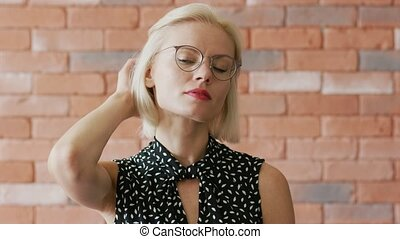 Elegant woman scratching head - Lovely young female in...