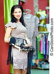 elegant woman shopping in retail store