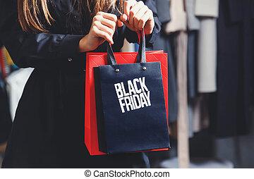 Elegant Woman Showing Black Friday Bag