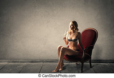Elegant woman sitting - Elegant in ligerie woman sitting
