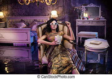 Elegant woman watching a movie in a conceptual flooded bedroom