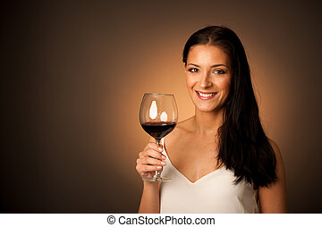 Elegant woman with a glass of red wine