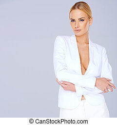 Elegant woman with a plunging neckline - Elegant blond woman...