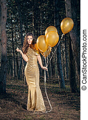 elegant woman with balloons in wood
