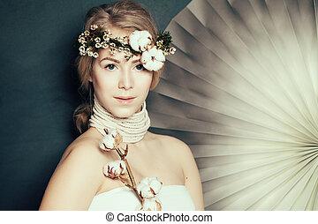 Elegant woman with healthy skin on fashion background