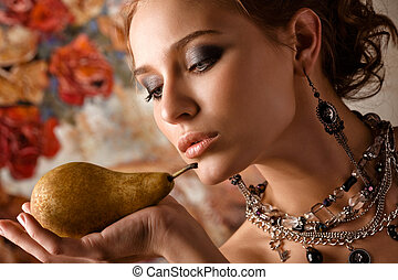 Elegant woman with pear.
