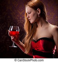 elegant woman with red hair holding wine glass