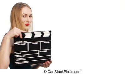 Fashion elegant woman with sexy red lips go, using clapper board and smiling, on white background