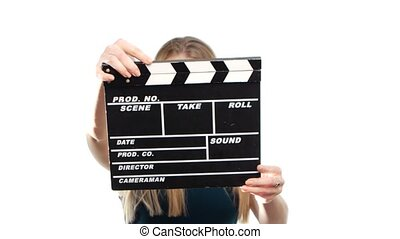 Elegant woman with sexy red lips holding clapper board and...