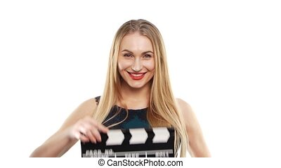 Elegant woman with sexy red lips using clapper board and...
