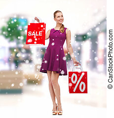 elegant woman with shopping bags in mall