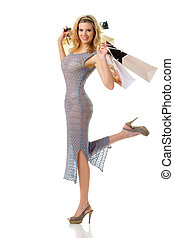 elegant woman with shopping bags looking at you