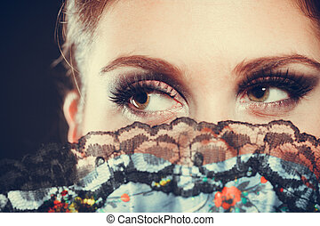 Elegant woman with strong make up.