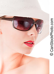 Elegant woman with sun glasses and white hat