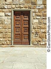 elegant wooden door and stone wall