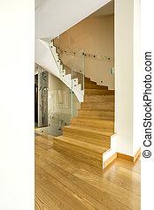 Elegant wooden staircase in modern interior