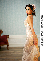 Elegant Young Bride Looking Over Her Shoulder - A young...