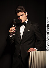 business man holding up a glass of champagne.