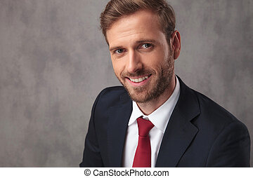 elegant young businessman portrait, smiling
